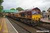 170911-007  On Monday 11th September 2017 DB Cargo class 66/0 No 66107 took five HTA hoppers to Shirebrook for 'cut & shut' mods at W H Davis's wagon works. It is seen passing through Shirebrook station with train 4M14, 06:16 Belmont Down Yard - Shirebrook (W H Davis). The hoppers were No's 310382, 405, 579, 709 & 755.