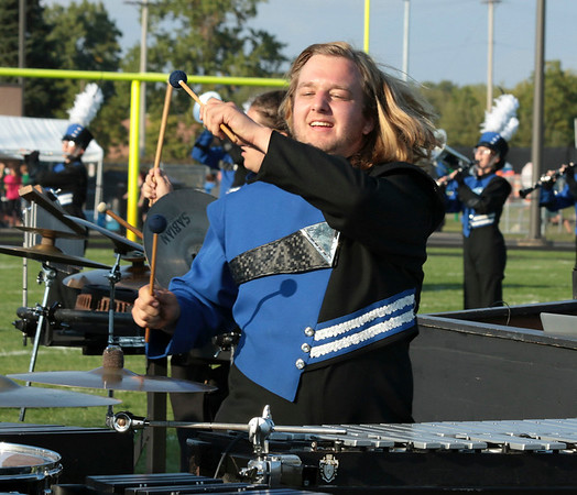 Isaiah Mumaw gets into his pit percussion performance for the Fairfield Marching Pride at<br /> Saturday's Concord invitational. Results from the competition and more photos are on Page A8.