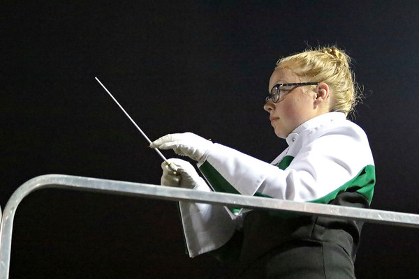 Ashley Herington, senior, directs the Marching Minutemen in exhibition during the band's Concord Invitational this past Saturday.