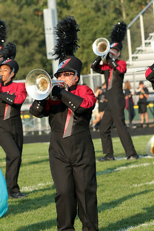 Joey Yaw, senior, plays the mellophone for the Red Regiment of NorthWood.