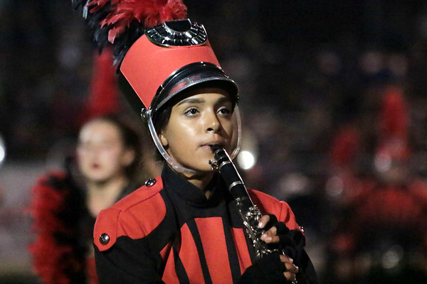 Joanna Regalado marches with her clarinet for the Crimson Marching Band at Saturday's Concord Invitational at Jake Field.