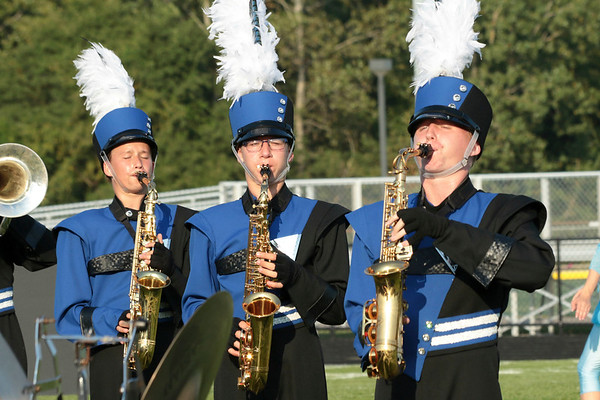 Cahleb Teall, Micah Mumaw and Chase Blucker march in the saxaphone line Fairfield at the<br /> Concord Invitational.