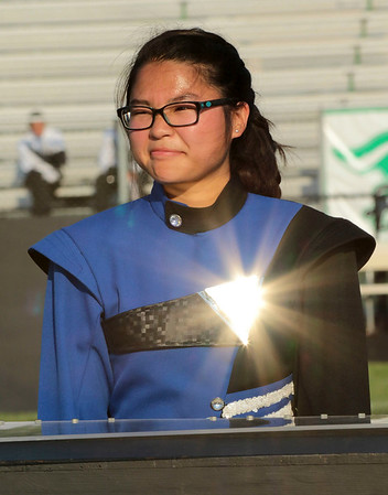 "Rebecca Parson sets up in the pit to begin Fairfield's show titled ""Pelagic,"" under a blazing<br /> afternoon sun at the Concord Invitational Saturday."