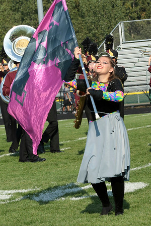 Drew Track flashes a smile for the judges at Concord Saturday, despite the glaring sun. Drew performed with the Marching Jimmies.