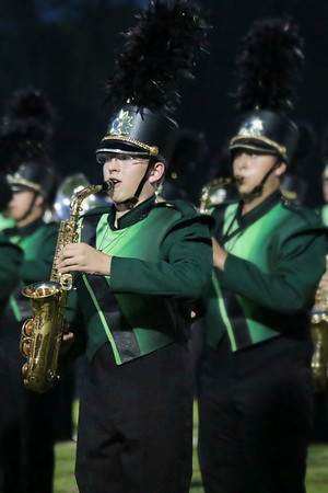 Eric Somme plays the saxophone during the Raider's winning Class B performance at the Concord invitational.