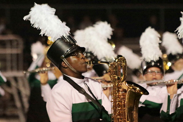 Jeremiah Coleman, bariton saxophone, marches in his last Concord Invitational as part of the Marching Minutemen, as they navigate Class A competition this season.