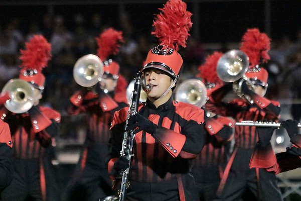 Mauricio Hernandez, bass clarinet, marches with Goshen at Concord's invitational.