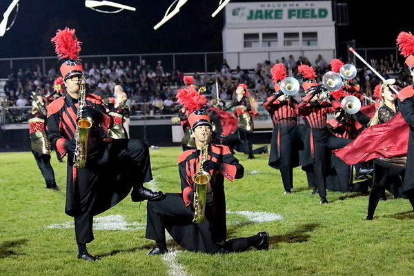 "Emmanuel Gomez standing, and Kevin Silva, kneeling, stike a pose during Goshen's ""Pyromania"" performance at Concord."