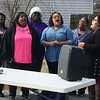 "PRAYER IN SONG—Former Pinhook Village residents sang a moving rendition of the ""Our Father"" prayer during the ground-breaking of seven homes in Sikeston on Jan. 26. Historic Pinhook was destroyed in 2011 when a levee was blown to alleviate area flooding. Catholic Charities of Southern Missouri partnered with other agencies to get families back into homes. (<i>The Mirror</i>)"