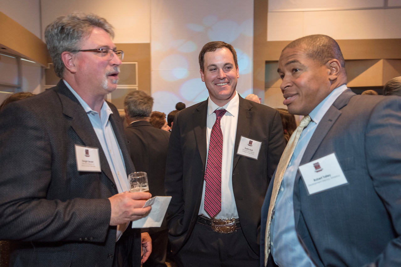 Dwight Seuser, Dustin Bush, Robert Talley (left to right),  guests and honorees enjoy the Distinguished Alumni Dinner on Friday, March 24, 2017 in Chico, Calif. (Jason Halley/University Photographer)