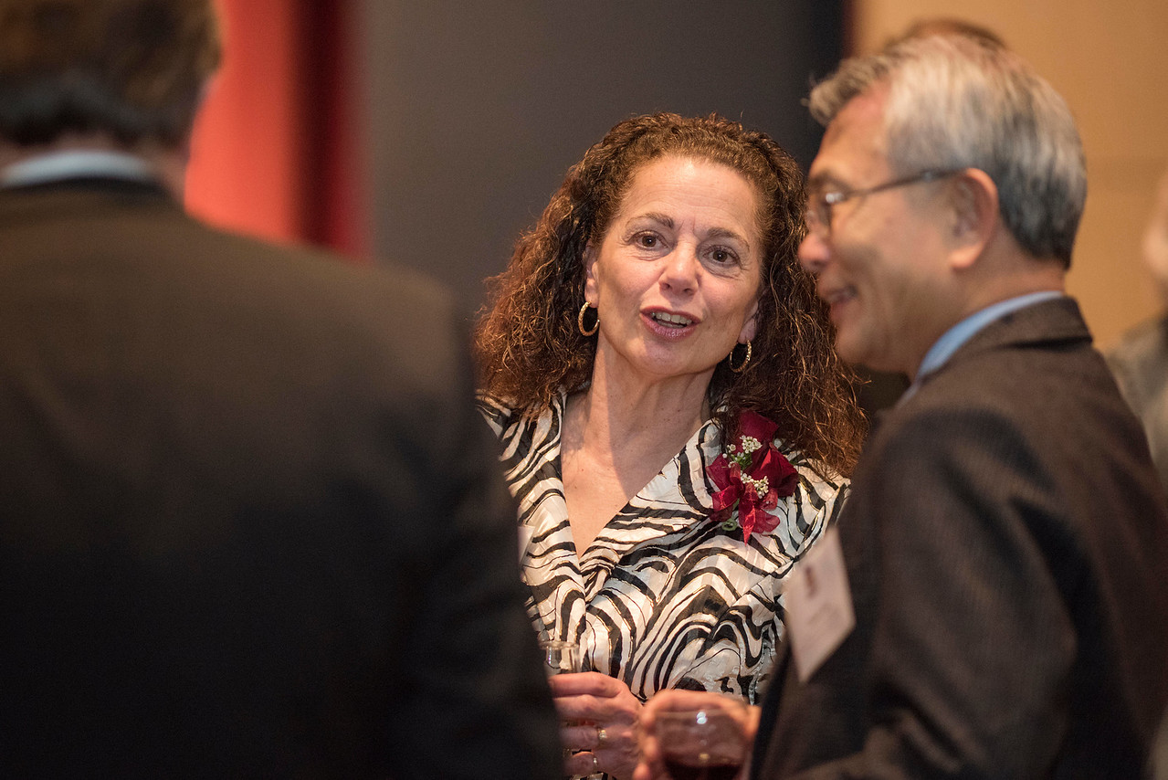 Rose Esposito-McCallen (center), guests and honorees enjoy the Distinguished Alumni Dinner on Friday, March 24, 2017 in Chico, Calif. (Jason Halley/University Photographer)