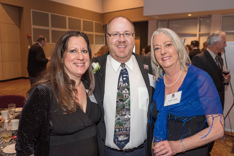 Donna Gauthier, Tim Colbie, Kathleen Hassig (left to right) guests and honorees enjoy the Distinguished Alumni Dinner on Friday, March 24, 2017 in Chico, Calif. (Jason Halley/University Photographer)