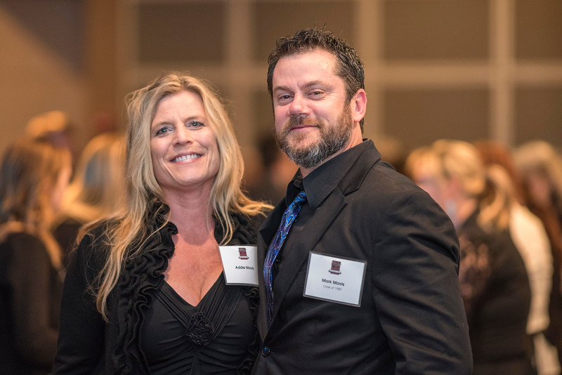 Addie Mavis (left), Mark Mavis (right), guests and honorees enjoy the Distinguished Alumni Dinner on Friday, March 24, 2017 in Chico, Calif. (Jason Halley/University Photographer)