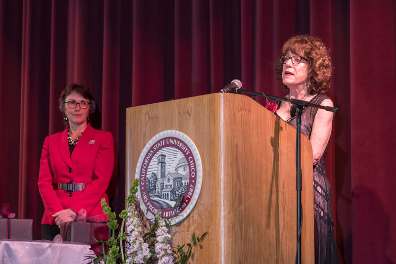 President Gayle Hutchinson (left) listens to Distinguished Alumni Candy Solari speak during the Distinguished Alumni Dinner on Friday, March 24, 2017 in Chico, Calif. (Jason Halley/University Photographer)