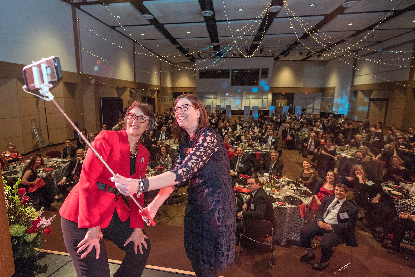 President Gayle Hutchinson (left) and Sue Anderson (right) take a selfie with guests and honorees that enjoy the Distinguished Alumni Dinner on Friday, March 24, 2017 in Chico, Calif. (Jason Halley/University Photographer)