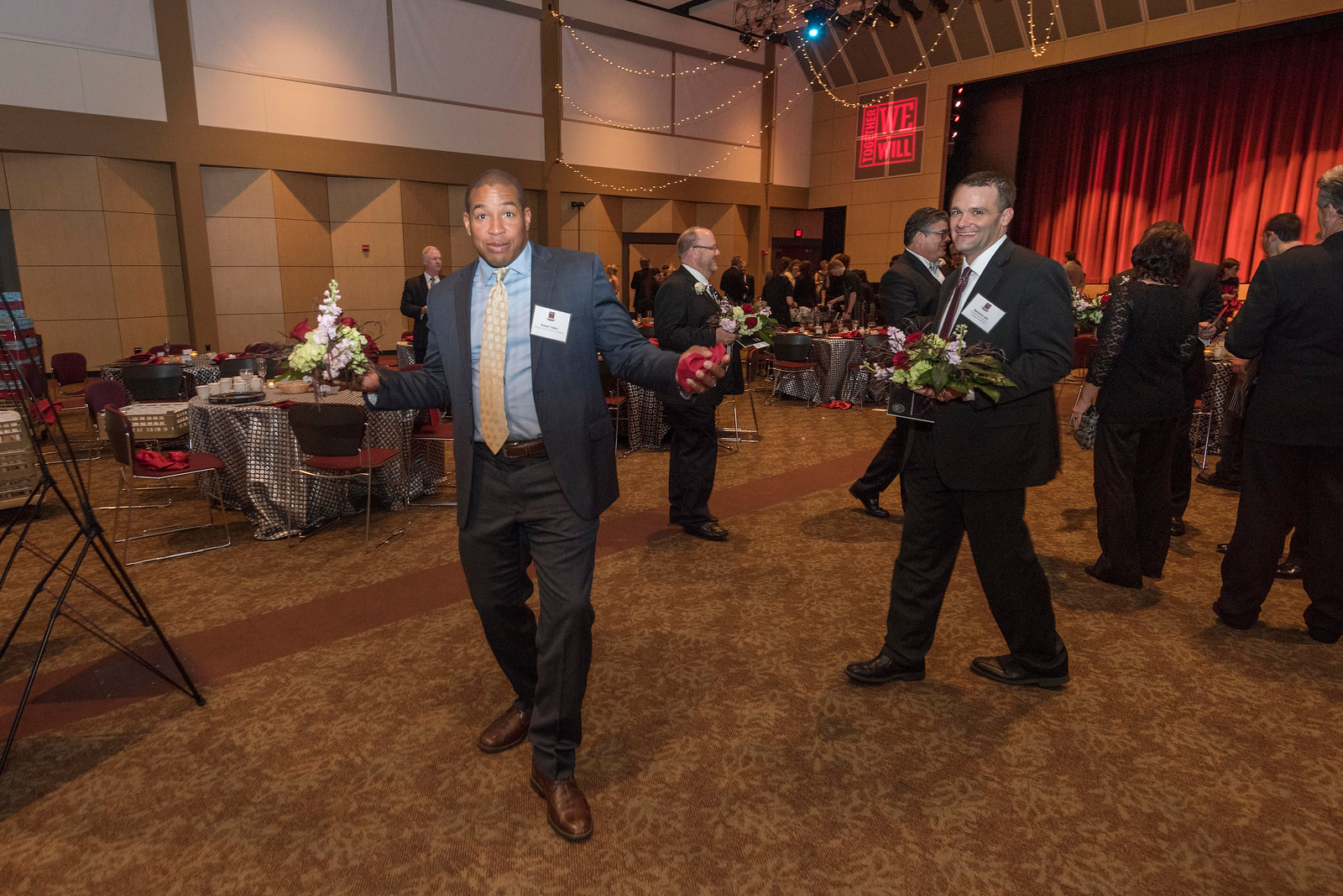 Robert Talley (center), guests and honorees enjoy the Distinguished Alumni Dinner on Friday, March 24, 2017 in Chico, Calif. (Jason Halley/University Photographer)