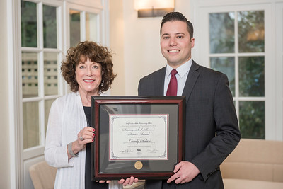 Candy Solari Distinguished Alumni Service Award recipient Candy Solari (BA, Psychology, 1986) (left) receives recognition by Aaron Skaggs (right) on Friday, March 24, 2017 in Chico, Calif. (Jason Halley/University Photographer)