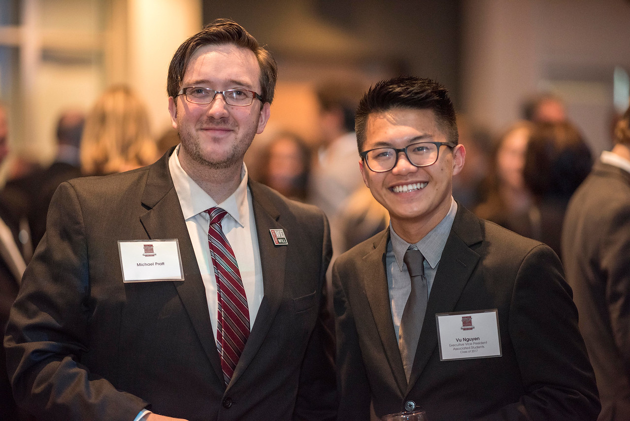 Associated Students President Michael Pratt (left), Vu Nguyen (right), guests and honorees enjoy the Distinguished Alumni Dinner on Friday, March 24, 2017 in Chico, Calif. (Jason Halley/University Photographer)