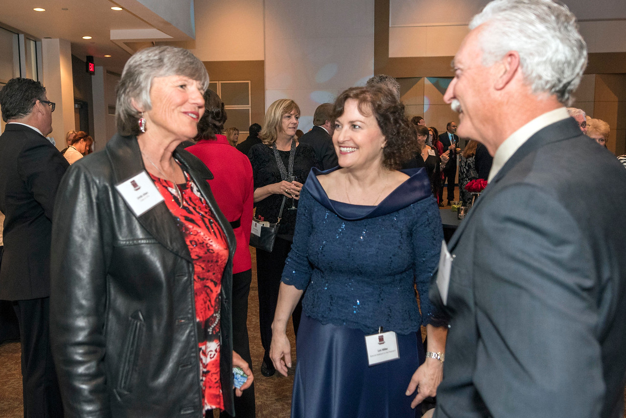 Linda Allen (left), Lori Miller (center), guests and honorees enjoy the Distinguished Alumni Dinner on Friday, March 24, 2017 in Chico, Calif. (Jason Halley/University Photographer)