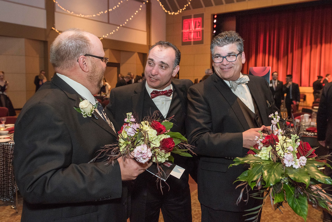 Tim Colbie, Ahmad Boura, Alan Rellaford (left to right), guests and honorees enjoy the Distinguished Alumni Dinner on Friday, March 24, 2017 in Chico, Calif. (Jason Halley/University Photographer)