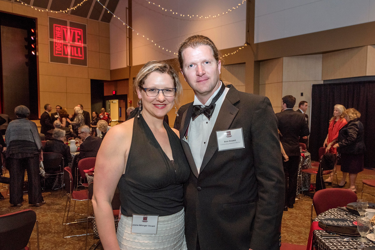 Ariane Bélanger-Vincent (left), Brian Brazeal (right), guests and honorees enjoy the Distinguished Alumni Dinner on Friday, March 24, 2017 in Chico, Calif. (Jason Halley/University Photographer)
