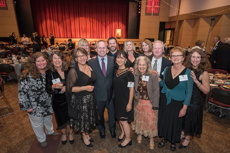 Distinguished Alumni Paul Lambros (center) with guests and honorees enjoy the Distinguished Alumni Dinner on Friday, March 24, 2017 in Chico, Calif. (Jason Halley/University Photographer)