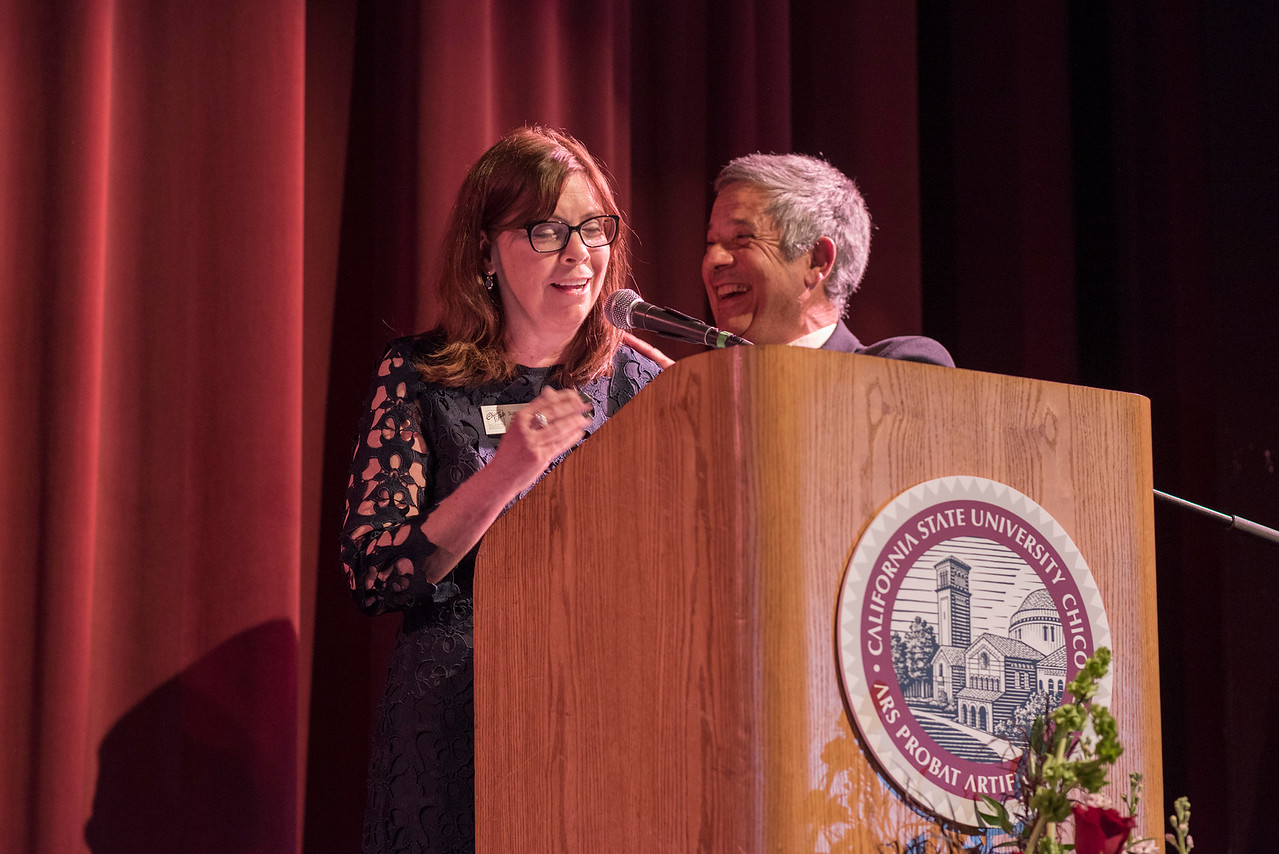 Sue Anderson (left) introduces Distinguished Alumni Jose Manuel Leal da Costa (right) as guests and honorees enjoy the Distinguished Alumni Dinner on Friday, March 24, 2017 in Chico, Calif. (Jason Halley/University Photographer)