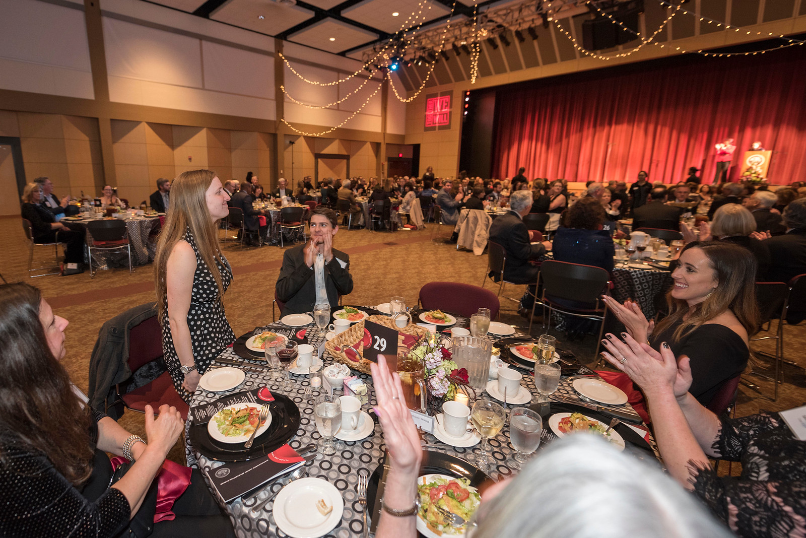 Keely Davis (left) is recognized as guests and honorees enjoy the Distinguished Alumni Dinner on Friday, March 24, 2017 in Chico, Calif. (Jason Halley/University Photographer)