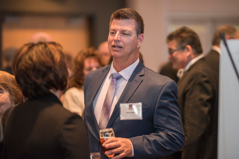 Kevin Kaise, guests and honorees enjoy the Distinguished Alumni Dinner on Friday, March 24, 2017 in Chico, Calif. (Jason Halley/University Photographer)