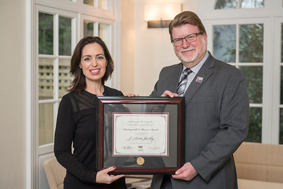 College of Humanities & Fine Arts Distinguished Alumni J'Anna Jacoby (BA, Music, 1987) (left) receives recognition by Robert Knight (Dean, HFA) (right) on Friday, March 24, 2017 in Chico, Calif. (Jason Halley/University Photographer)