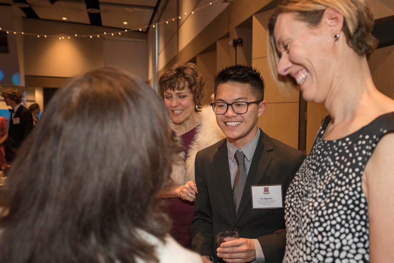 Angela Trethewey (Dean, CME), Vu Nguyen, Jennifer Meadows (left to right), guests and honorees enjoy the Distinguished Alumni Dinner on Friday, March 24, 2017 in Chico, Calif. (Jason Halley/University Photographer)