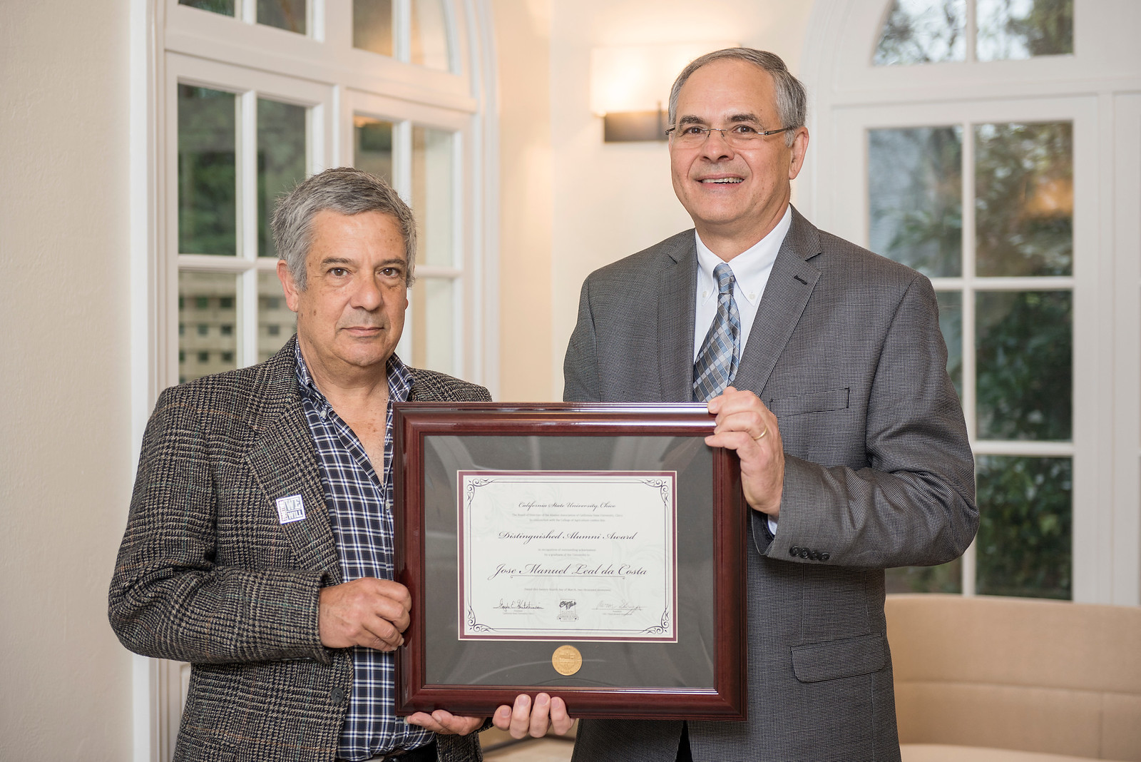 College of Agriculture Distinguished Alumni Jose Manuel Leal da Costa (BS, Agricultural Mechanics, 1984) (left) receives recognition by John Unruh (Dean, AG) (right) on Friday, March 24, 2017 in Chico, Calif. (Jason Halley/University Photographer)