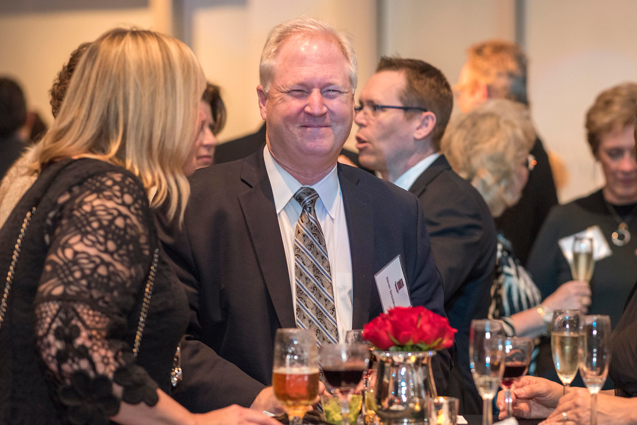 Steven Spaulding (center), guests and honorees enjoy the Distinguished Alumni Dinner on Friday, March 24, 2017 in Chico, Calif. (Jason Halley/University Photographer)