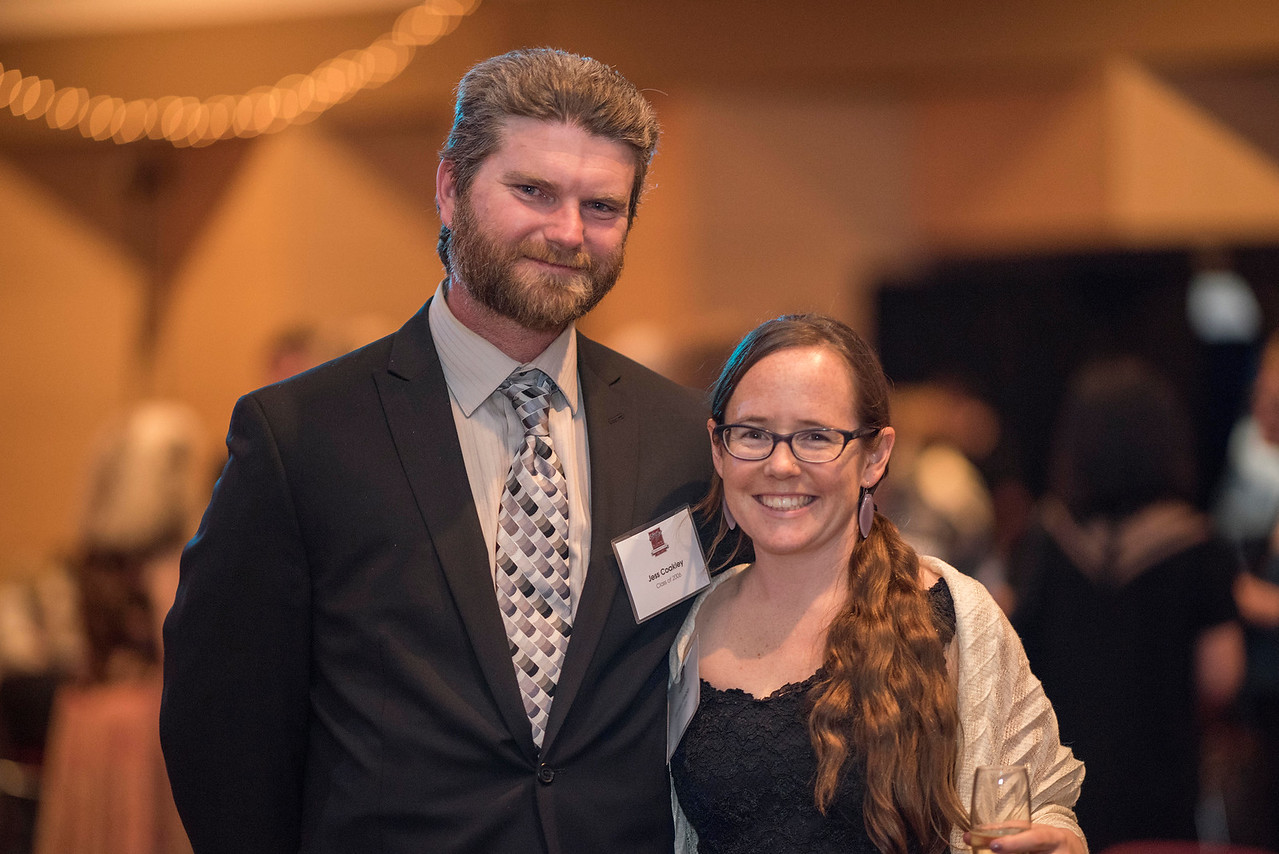 Jess Coakley (left), Ashley Gebb (right), guests and honorees enjoy the Distinguished Alumni Dinner on Friday, March 24, 2017 in Chico, Calif. (Jason Halley/University Photographer)