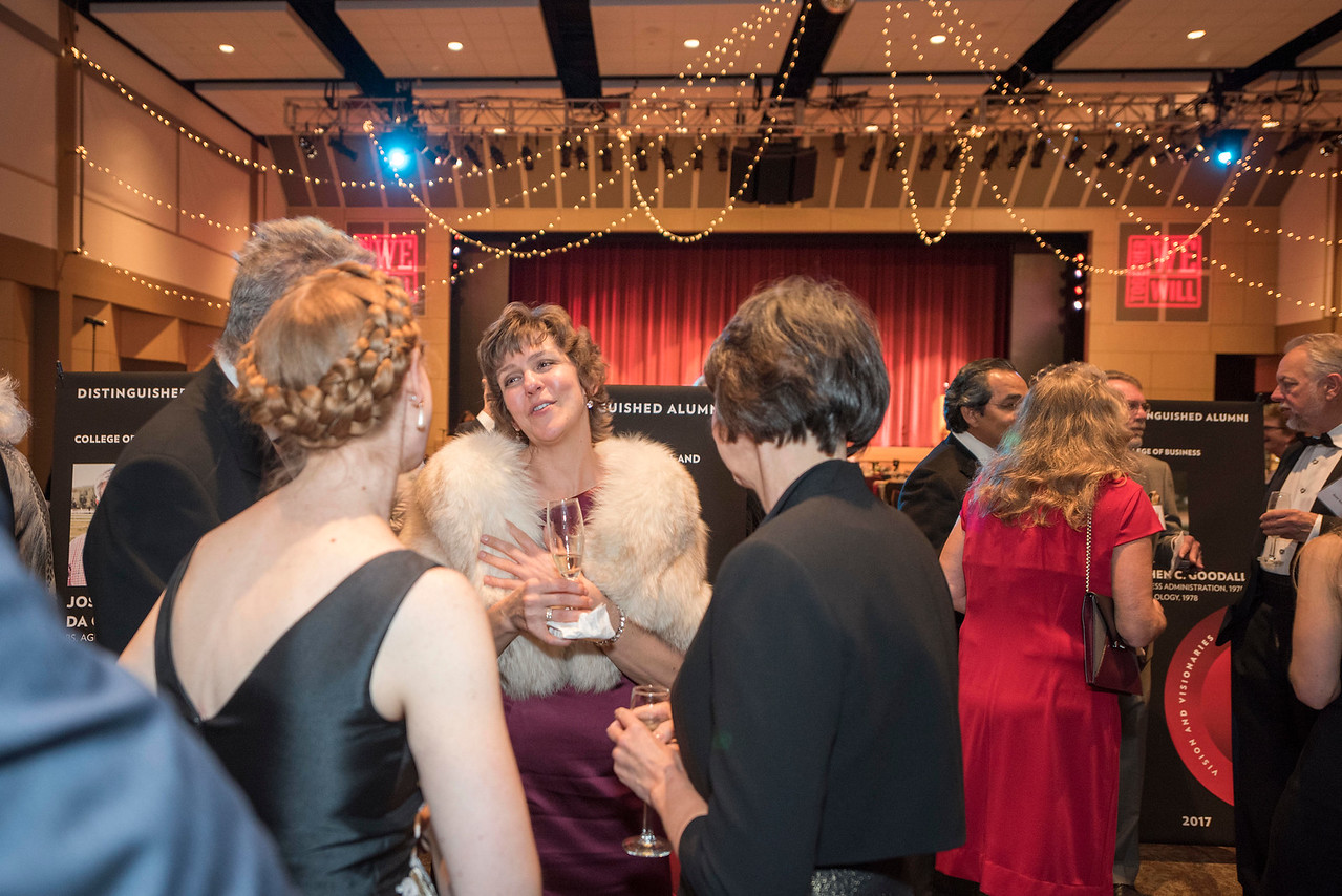 Angela Trethewey (Dean, CME) (center), guests and honorees enjoy the Distinguished Alumni Dinner on Friday, March 24, 2017 in Chico, Calif. (Jason Halley/University Photographer)