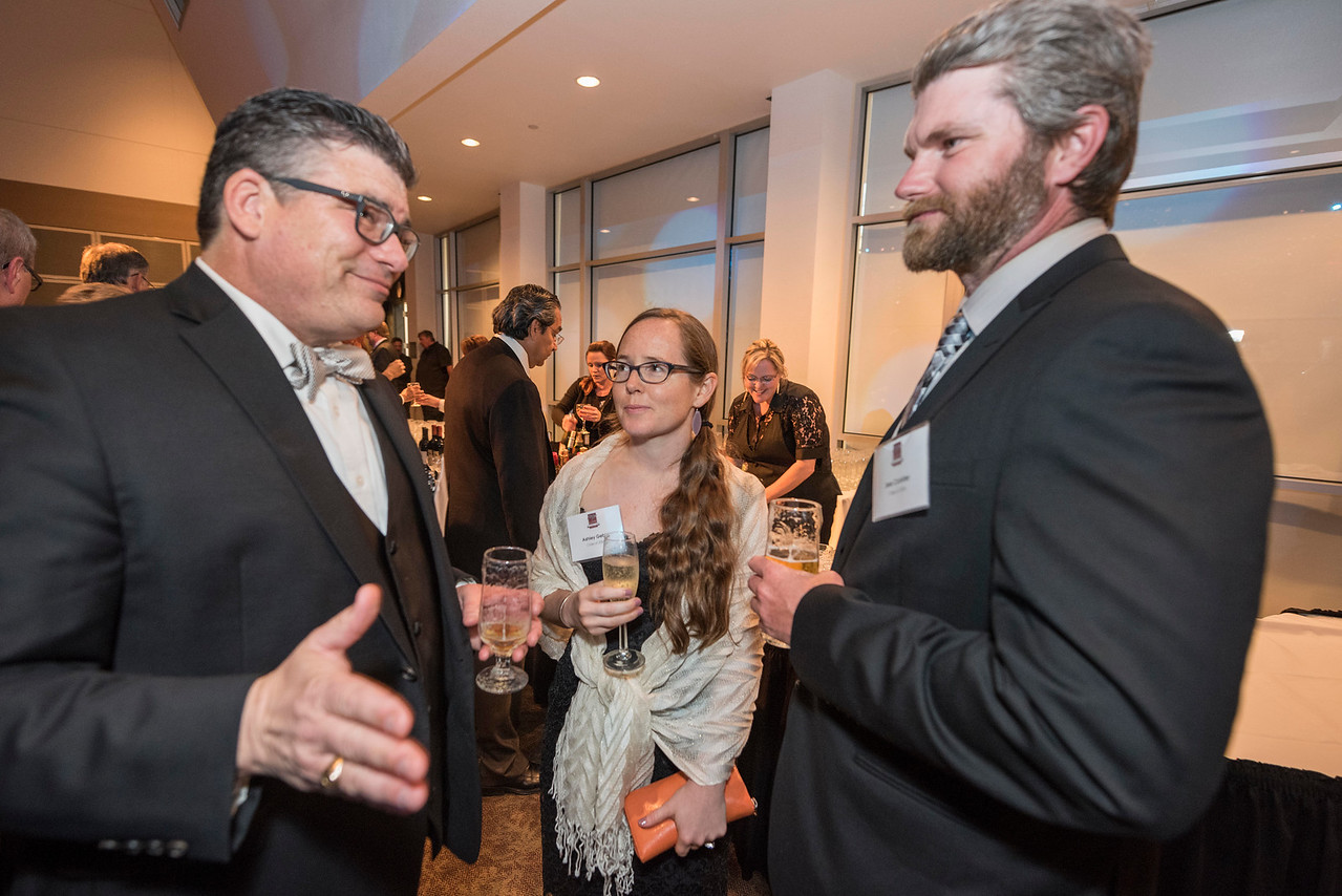 Alan Rellaford, Ashley Gebb, Jesse Coakley (left to right), guests and honorees enjoy the Distinguished Alumni Dinner on Friday, March 24, 2017 in Chico, Calif. (Jason Halley/University Photographer)