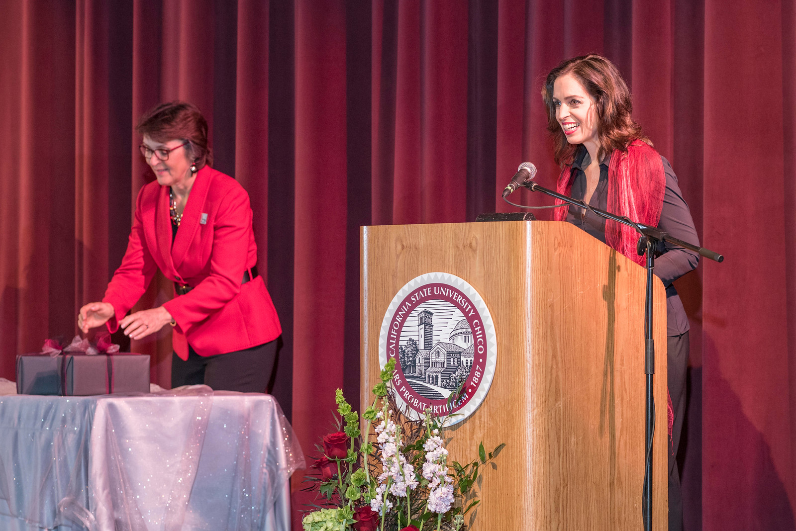 President Gayle Hutchinson (left) listens to Distinguished Alumni J'Anna Jacoby (right) talk to guests and honorees during the Distinguished Alumni Dinner on Friday, March 24, 2017 in Chico, Calif. (Jason Halley/University Photographer)