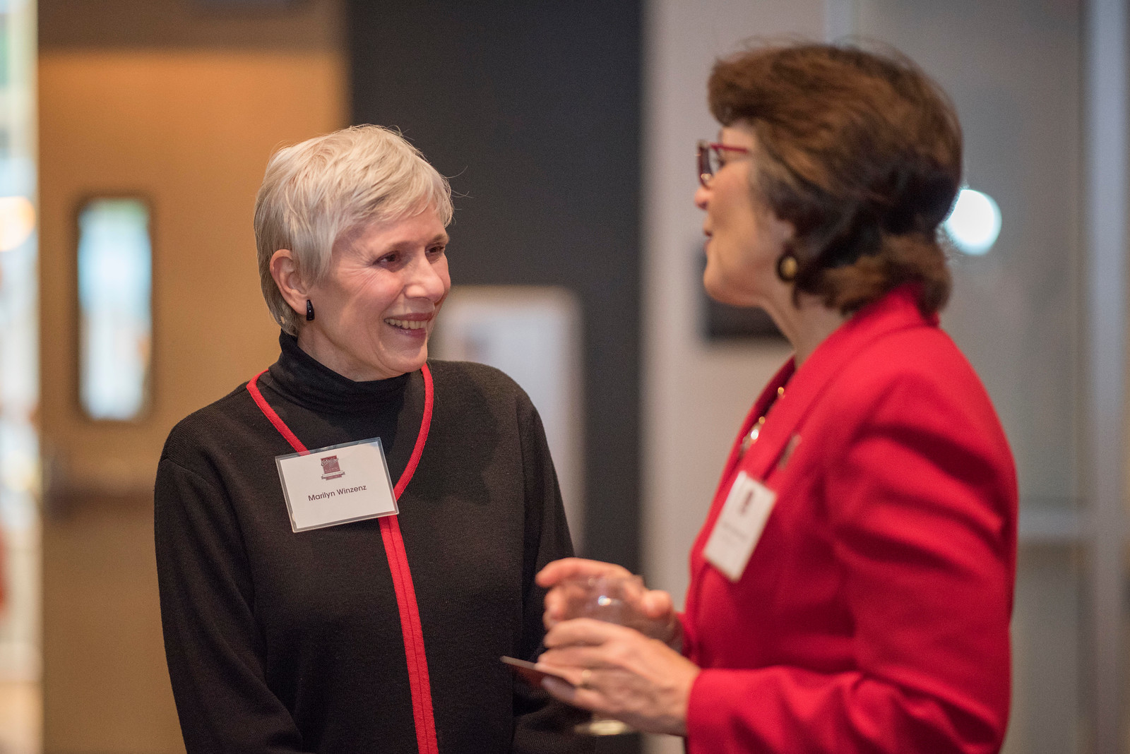 Marilyn Winzenz (left) talks with President Gayle Hutchinson (right) as guests and honorees enjoy the Distinguished Alumni Dinner on Friday, March 24, 2017 in Chico, Calif. (Jason Halley/University Photographer)