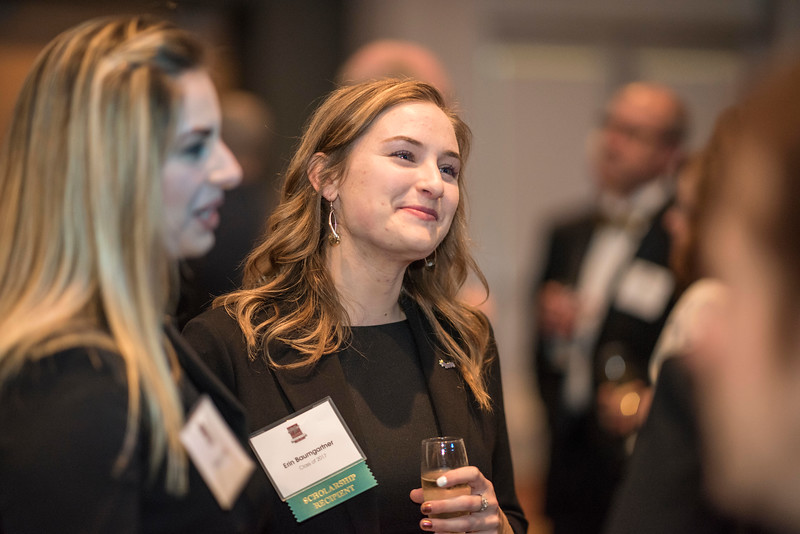 Erin Baumgartner, guests and honorees enjoy the Distinguished Alumni Dinner on Friday, March 24, 2017 in Chico, Calif. (Jason Halley/University Photographer)