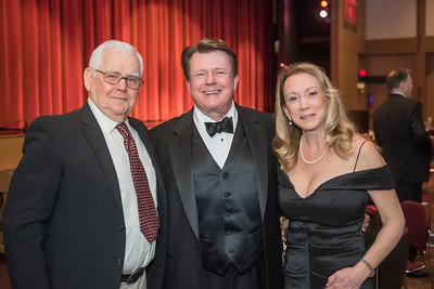 George Rogers (left) Distinguished Alumni Michael Finney (center) with his wife (right) as guests and honorees enjoy the Distinguished Alumni Dinner on Friday, March 24, 2017 in Chico, Calif. (Jason Halley/University Photographer)