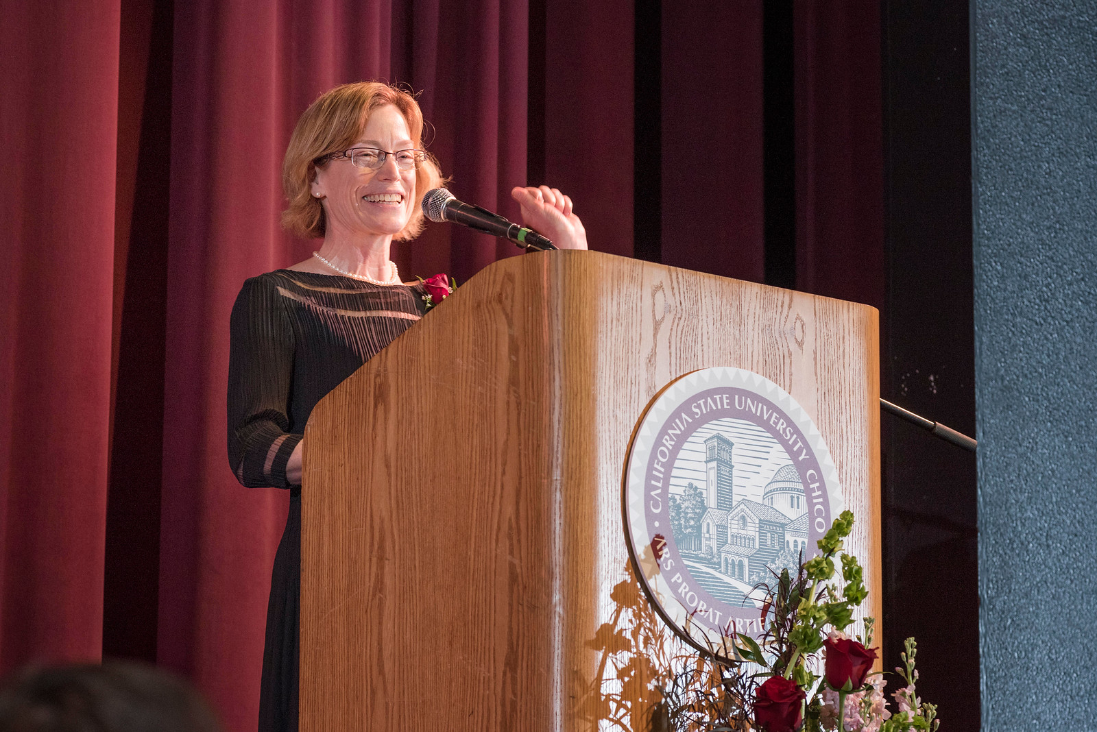 Distinguished Alumni Jenelle Ball talks to guests and honorees during the Distinguished Alumni Dinner on Friday, March 24, 2017 in Chico, Calif. (Jason Halley/University Photographer)