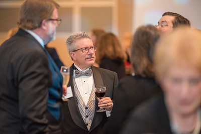 Rick Anderson, guests and honorees enjoy the Distinguished Alumni Dinner on Friday, March 24, 2017 in Chico, Calif. (Jason Halley/University Photographer)