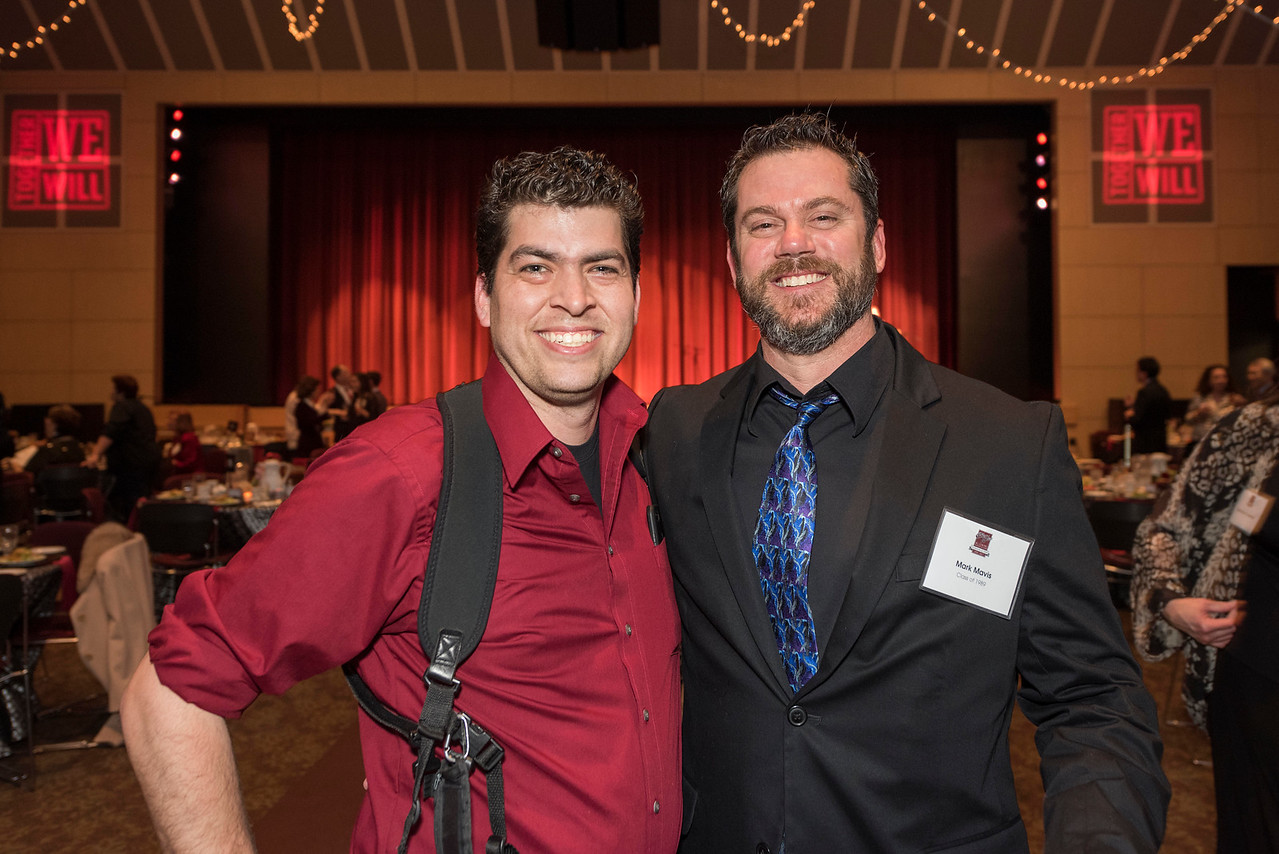 University Photographer Jason Halley (left), Mark Mavis (right), guests and honorees enjoy the Distinguished Alumni Dinner on Friday, March 24, 2017 in Chico, Calif. (Photo by Paul Lambros)