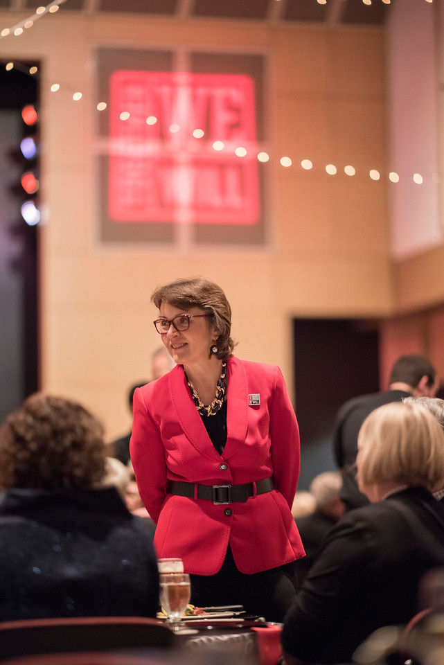 President Gayle Hutchinson (center) talks with guests and honorees enjoy the Distinguished Alumni Dinner on Friday, March 24, 2017 in Chico, Calif. (Jason Halley/University Photographer)