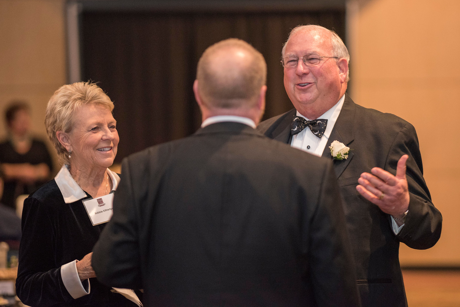 Bobbie Kittredge (left), Robert Kittredge (right), guests and honorees enjoy the Distinguished Alumni Dinner on Friday, March 24, 2017 in Chico, Calif. (Jason Halley/University Photographer)