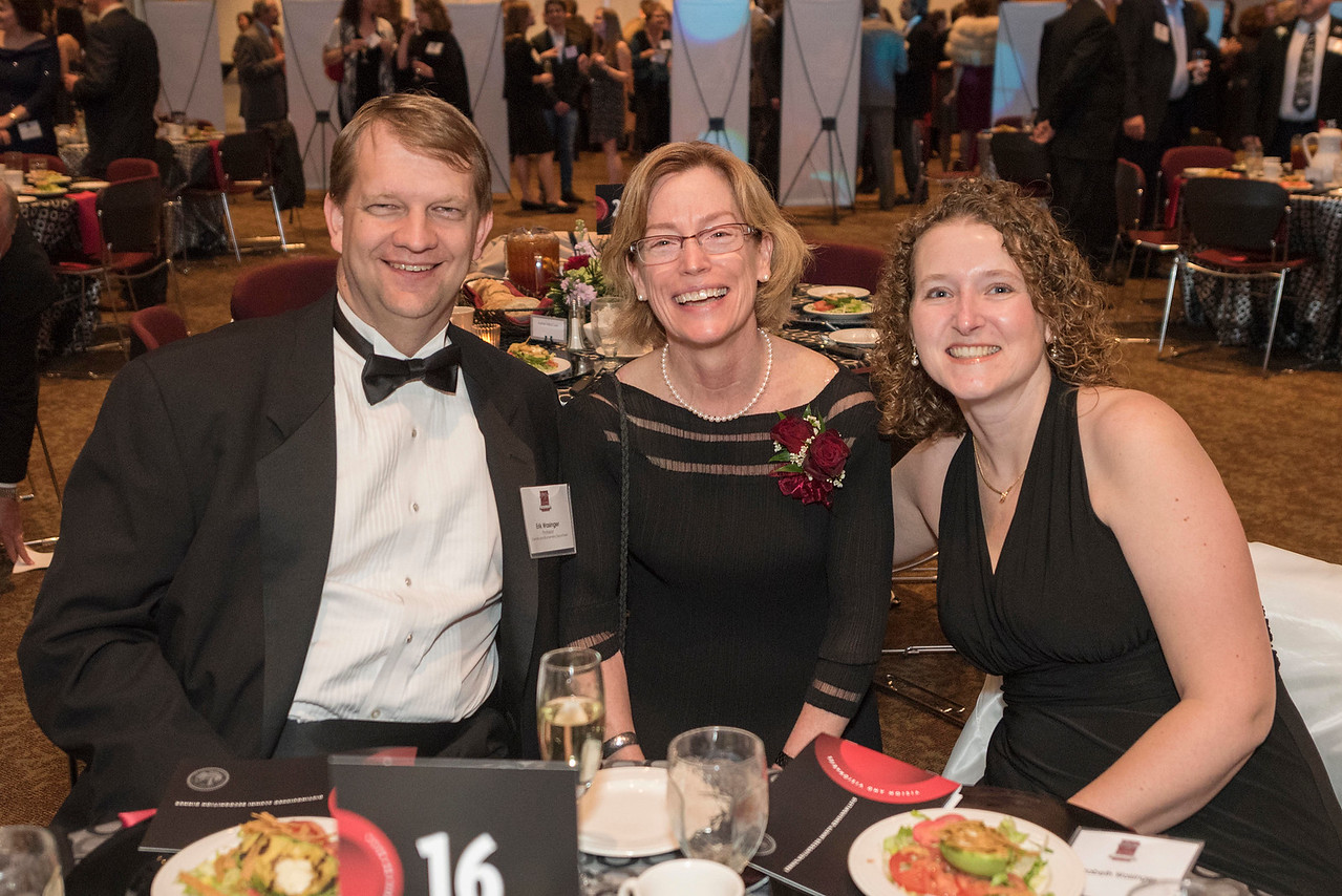 Erik Wasinger (left), Distinguished Alumni Jenelle Ball (center), guests and honorees enjoy the Distinguished Alumni Dinner on Friday, March 24, 2017 in Chico, Calif. (Jason Halley/University Photographer)