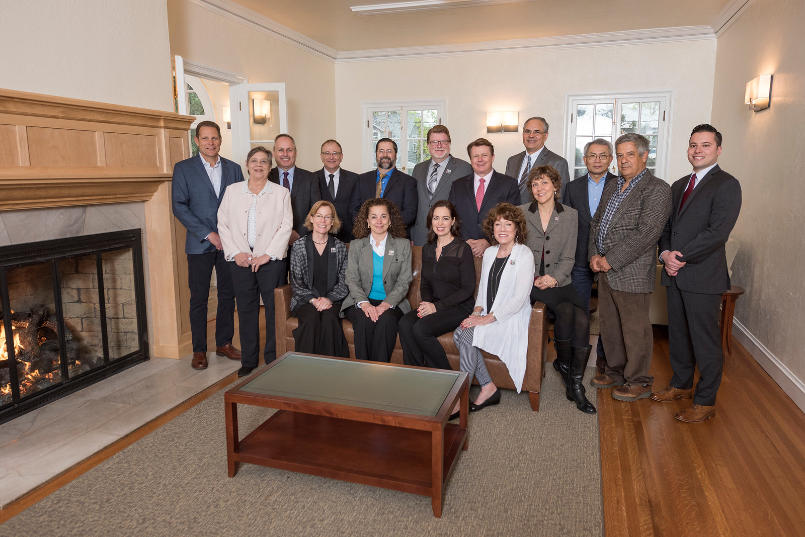 Distinguished Alumni and Deans Stephen C. Goodall, Judith Hennessey, Paul Lambros, Eddie Vela, David Hassenzahl, Robert Knight, Michael Finney, John Unruh, Chuen Hsu, Jose Manuel Leal da Costa, Aaron Skaggs (standing, left to right) with Jenelle Ball, Rose Esposito-McCallen, J'Anna Jacoby, Candy Solari and Angela Trethewey (sitting, left to right) take a group photo in the Warrens Reception Center on Friday, March 24, 2017 in Chico, Calif. (Jason Halley/University Photographer)