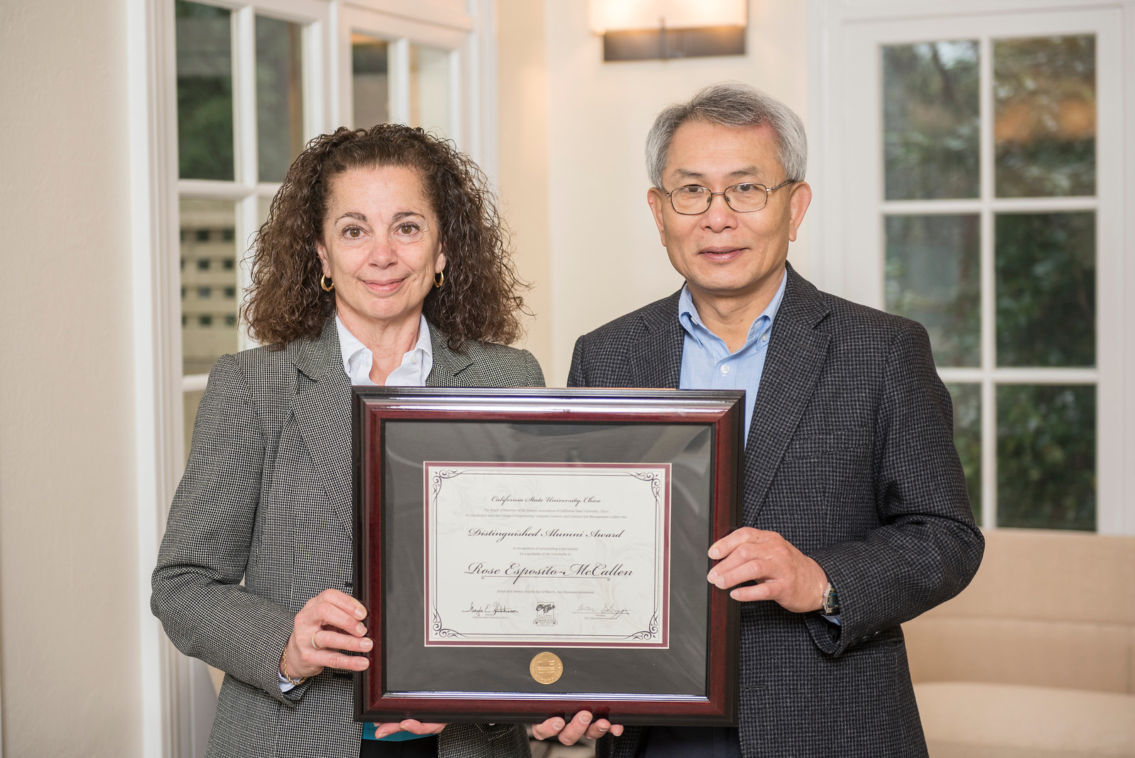 College of Engineering, Computer Science, and Construction Management Distinguished Alumni Rose Esposito-McCallen (BS, Mechanical Engineering, 1980) (left) receives recognition by Chuen H. Hsu (right) on Friday, March 24, 2017 in Chico, Calif. (Jason Halley/University Photographer)