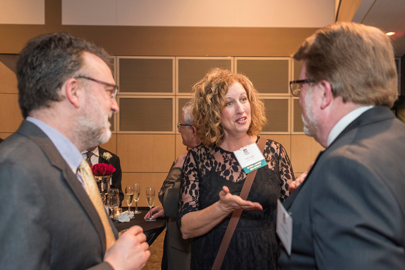 Holly Taylor (center) talks with guests and honorees that enjoy the Distinguished Alumni Dinner on Friday, March 24, 2017 in Chico, Calif. (Jason Halley/University Photographer)