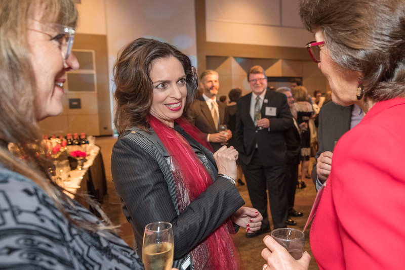 J'Anna Jacoby (left) greets President Gayle Hutchinson (right) as guests and honorees enjoy the Distinguished Alumni Dinner on Friday, March 24, 2017 in Chico, Calif. (Jason Halley/University Photographer)